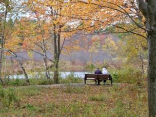 A couple enjoys the fall foliage at Heins Farm
