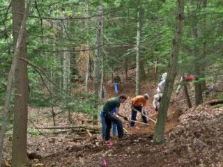Participants in the course help build a single track