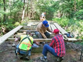 Members of the trail committee construct Bridge 8
