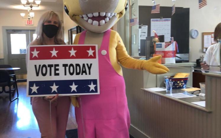 Town Clerk Lynne Girouard helps Penelope Rex Early Vote